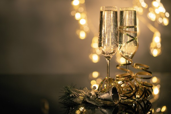 close-up-of-two-flute-glasses-filled-with-sparkling-wine-3036525-e1576073292593-1